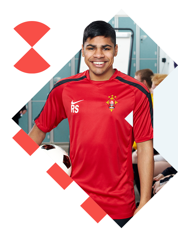 Sports Coaching student holding a football.