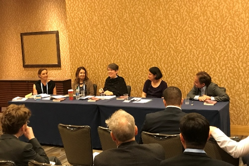 Professor Reverend Jane de Gay sits on a panel at the American Academy of Religion conference.