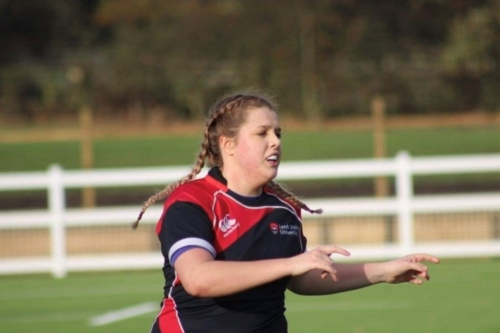 Megan Price playing rugby.